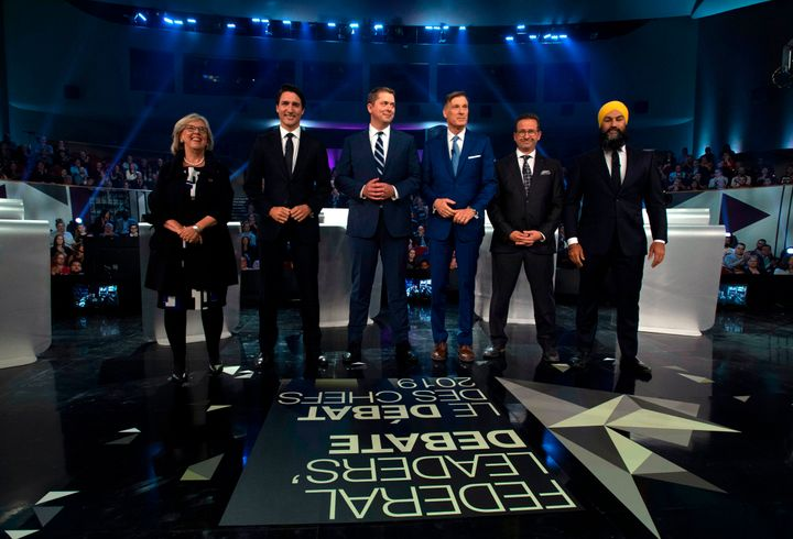 From left, Green Party of Canada Leader Elizabeth May, Liberal Leader Justin Trudeau, Conservative Leader Andrew Scheer, People's Party of Canada Leader Maxime Bernier, Bloc Quebecois Leader Yves-Francois Blanchet and NDP Leader Jagmeet Singh pose for a photograph before the Federal Leaders Debate in Gatineau, Que., on Oct. 7, 2019.