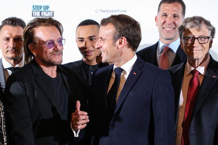 Le seuil des 14 milliards de dollars (presque) atteint à Lyon contre les maladies infectieuses (ici une photo de Bono du groupe U2, le créateur Olivier Rousteing, le président Emmanuel Macron, Bill & Melinda Gate à Lyon le 9 octobre)