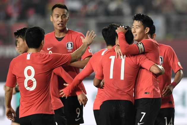 South Korea's Son Heung-min (R) celebrates his goal with teammates against Sri Lanka during their World...