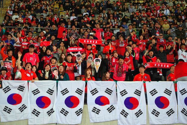 South Korea's football fans cheer up during the World Cup 2022 Qualifying Asian zone Group H football...