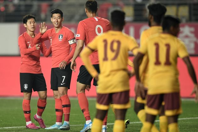 South Korea's Son Heung-min (2nd L) celebrates his goal with teammates against Sri Lanka during their...