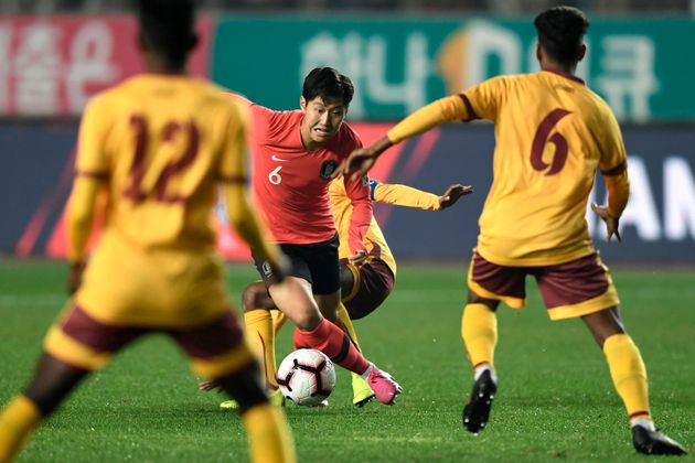 South Korea's Lee Kang-in (C) dribbles the ball against Sri Lanka during their World Cup 2022 Qualifying...