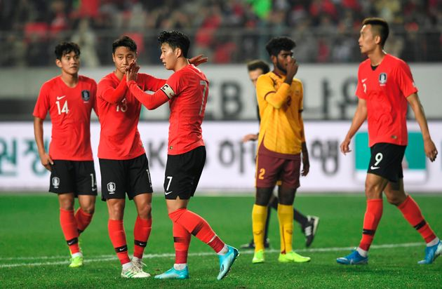 South Korea's Son Heung-min (3rd L) celebrates his goal with teammates against Sri Lanka during their...