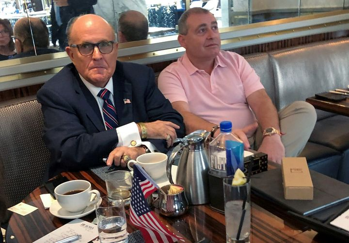 Rudy Giuliani has coffee with Ukrainian-American businessman Lev Parnas at the Trump International Hotel in Washington, D.C.,