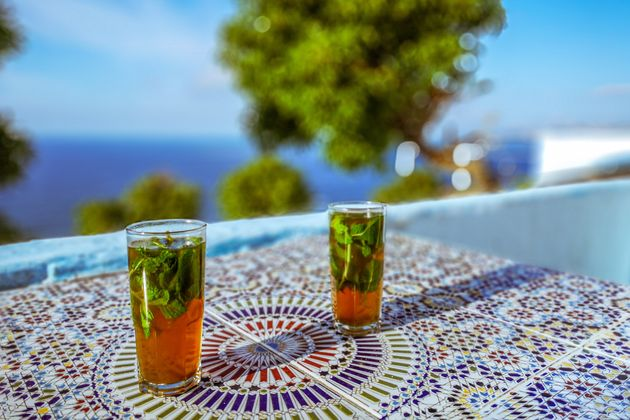 Moroccan mint tea on a terrace with sea view in Tangier,