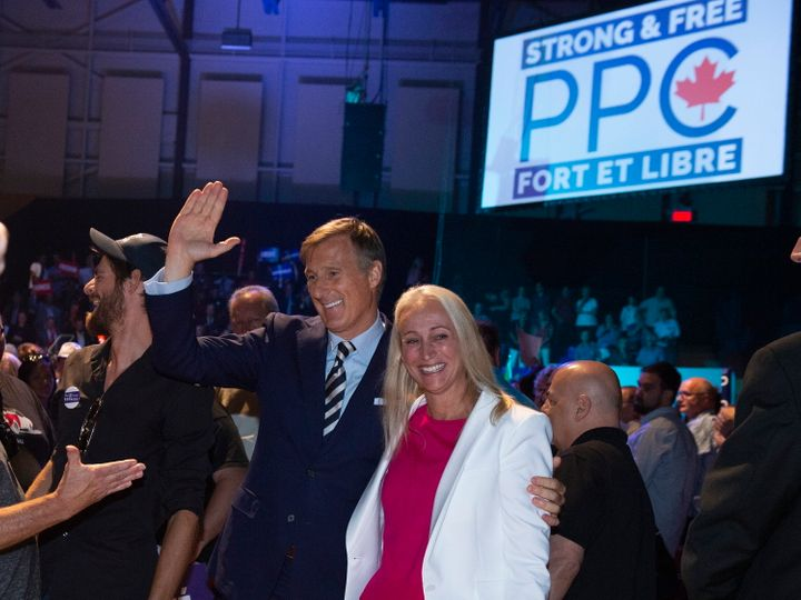 Maxime Bernier and his wife Catherine Letarte leave the room at the launch of his campaign on Aug. 25, 2019 in Sainte-Marie Que.