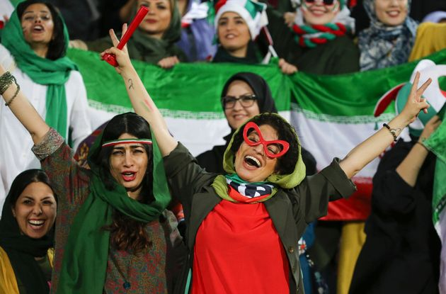 Iranian women cheer during the World Cup Qatar 2022 Group C qualification football match between Iran...