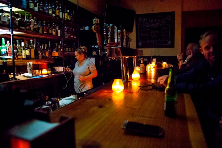 A candle-lit bar in Sonoma, California, amid a wide power outage that is expected to last several days.
