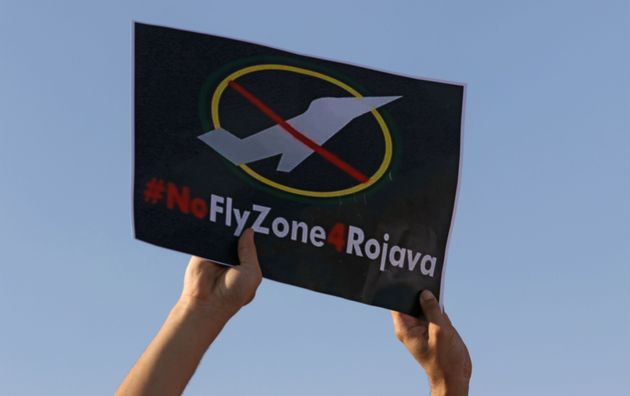 A Kurdish protester holds a placard during a demonstration in Arbil, the capital of the northern Iraqi...