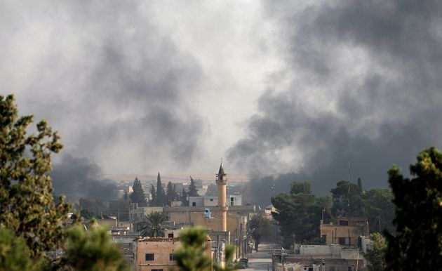 Smoke rises over the Syrian town of Tel Abyad, as seen from the Turkish border town of Akcakale in Sanliurfa...