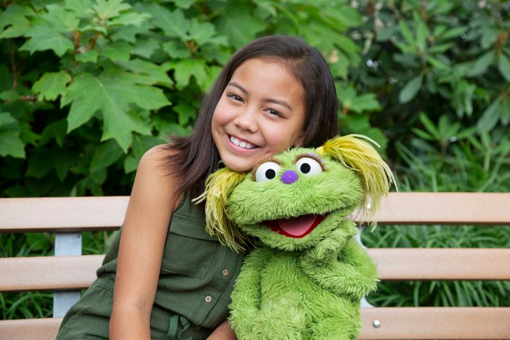 "Salia Woodbury, 10, whose parents are in recovery from addiction, with ""Sesame Street"" character Karli."