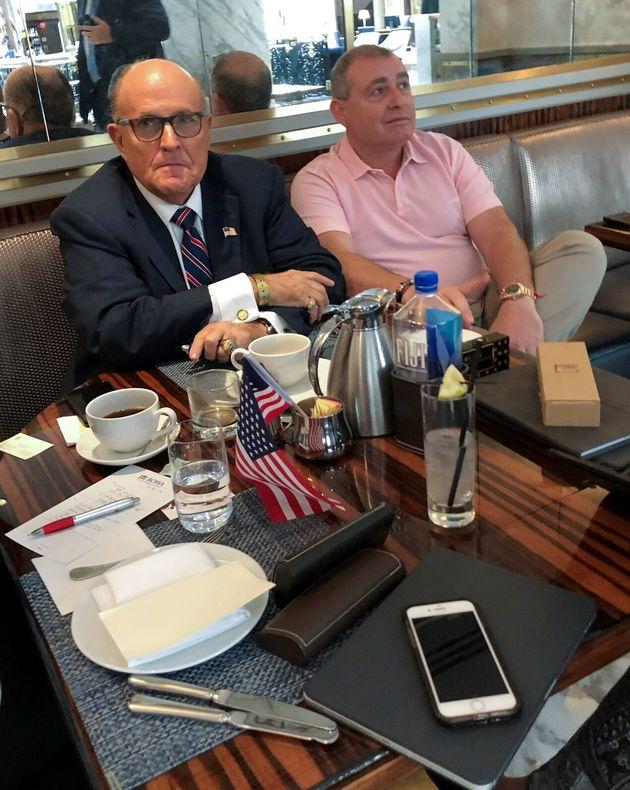 U.S. President Trump's personal lawyer Rudy Giuliani has coffee with Ukrainian-American businessman Lev...