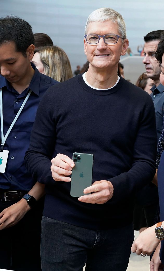 Apple CEO Tim Cook, holds the new iPhone 11 Pro Max, during an event to announce new products Tuesday,...