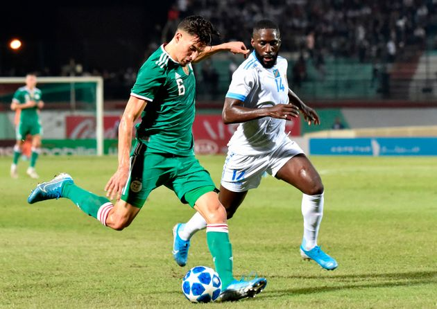 Algeria's Zinedine Ferhat (L) vies for the ball with DR Congo's Arthur Masuaku during the friendly football...