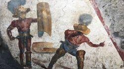 A Pompei è stato scoperto un nuovo affresco: ritrae due gladiatori