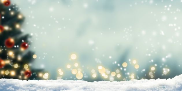 winter background with blurred xmas tree and bokeh