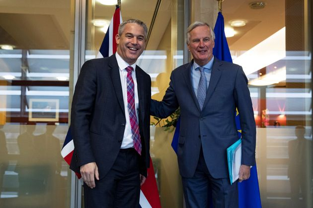 Britain's Brexit Secretary Stephen Barclay poses with European Union's chief Brexit negotiator Michel...