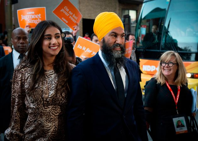 NDP Leader Jagmeet Singh smiles with his wife beside him in Quebec on Oct. 2, 2019, before his appearance...