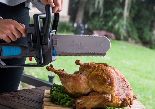 "Need a cutting-edge way to carve a turkey? Get one <a href=""MightyCarver.com"" target=""_blank"">shaped like a chainsaw!</a> Lat"