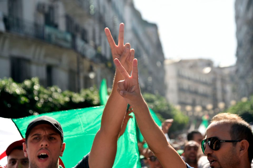 Algerian demonstrators take part in an anti-government protest in the capital Algiers on October 11,...