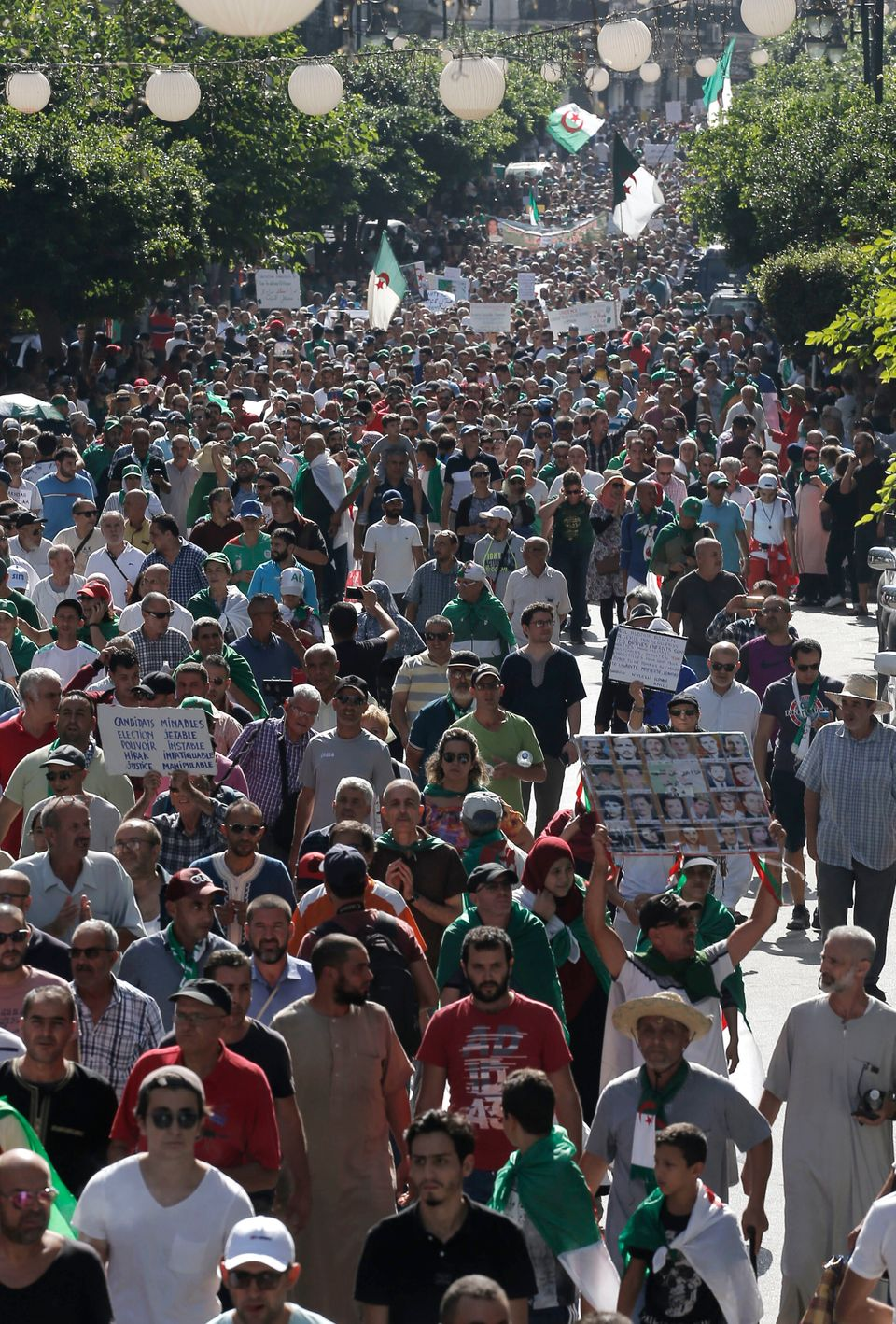Algerians take part in a protest against the government in Algiers, Algeria, Friday, Oct. 11, 2019. Thousands...