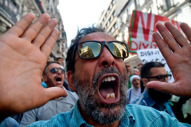 Algerians shout slogans during an anti-government protest in the capital Algiers on October 11, 2019....
