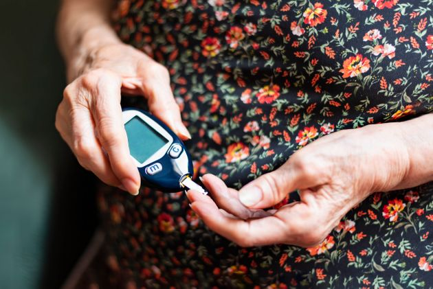 Old lady tracking her glucose levels. Health