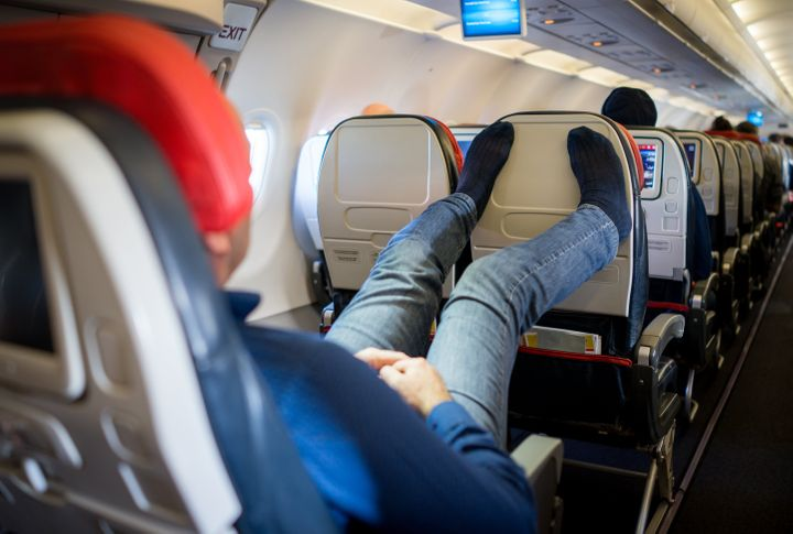 Etiquette experts caution against taking your shoes off during a flight.