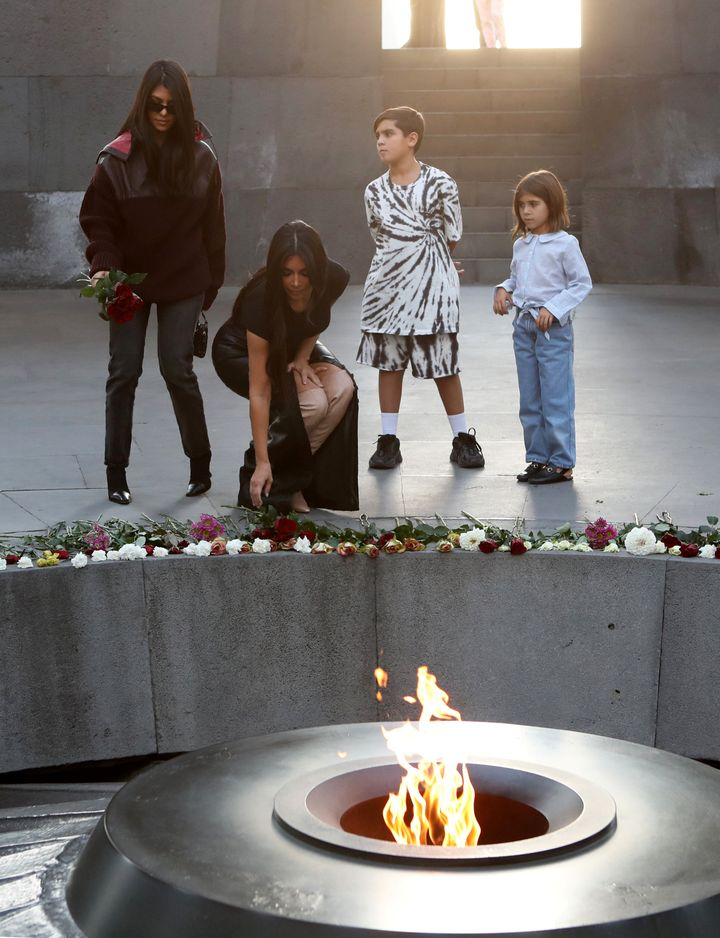 Reality TV personality Kim Kardashian and her sister Kourtney Kardashian with children visit the Armenian Genocide Memorial i