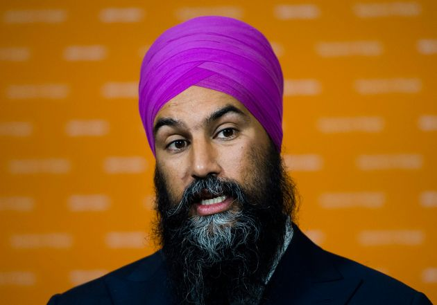 NDP Leader Jagmeet Singh answers question from the media during a campaign stop in Ottawa on