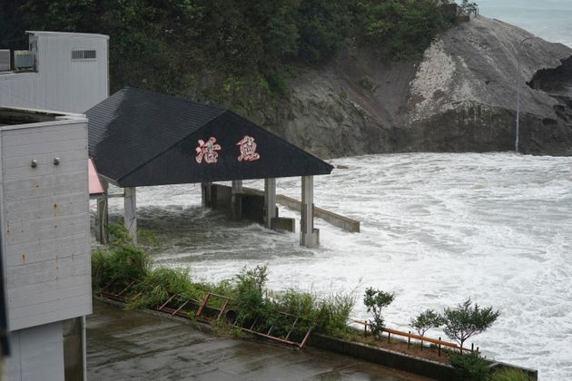 Surging waves comes into port over the breakwater while Typhoon Hagibis approaches in Kumano, Mie Prefecture,...