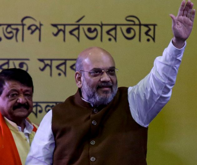 Indian Home Minister Amit Shah, waves to supporters in Kolkata, India, Tuesday, Oct. 1, 2019. Shah says...