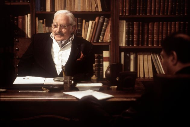 Italian actor Carlo Croccolo sitting at a writing desk in the scene of a film. 1990s. (Photo by Rino...