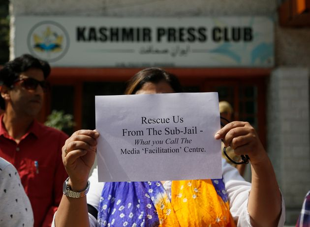 A Kashmiri journalists displays a placard during a protest against the communication blackout in Srinagar,...