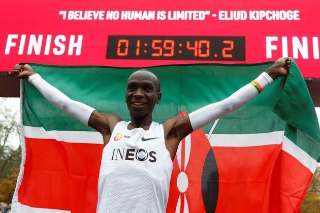 Kenya's Eliud Kipchoge, the marathon world record holder, celebrates after a successful attempt to run...