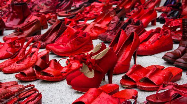 CAGLIARI, ITALY - NOVEMBER 25, 2017: Zapatos rojos by Elina Chauvet near Piazza Garibaldi -