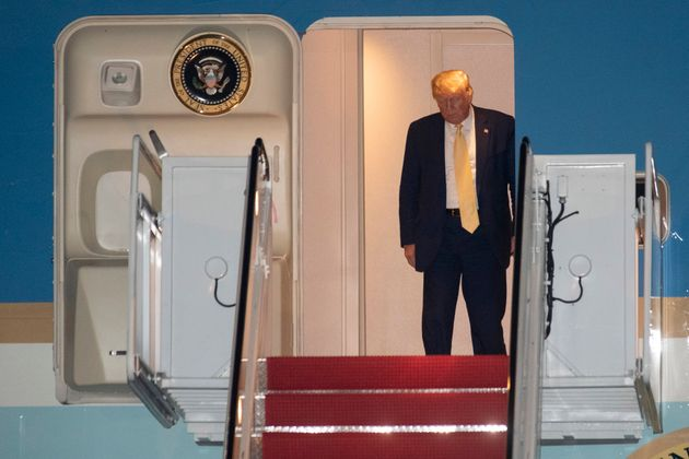 President Donald Trump prepares to depart Air Force One early Saturday, Oct. 12, 2019, at Andrews Air...