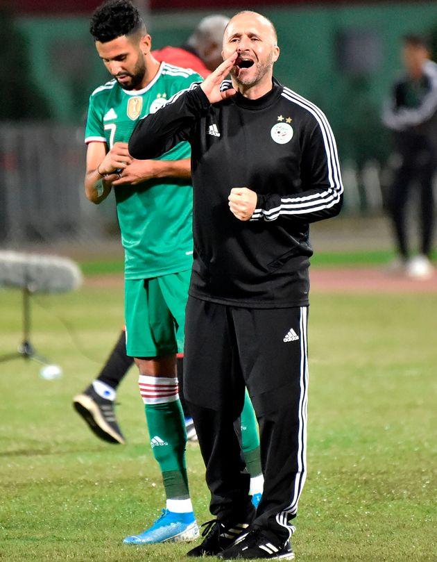 Algeria's player Riyad Mahrez (L) and head coach Djamel Belmadi gesture during the friendly football...