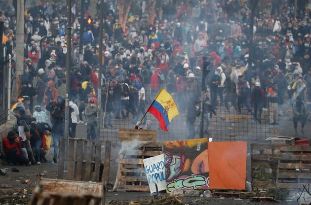 Demonstrators during a protest against Ecuador's President Lenin Moreno's austerity measures in Quito,...