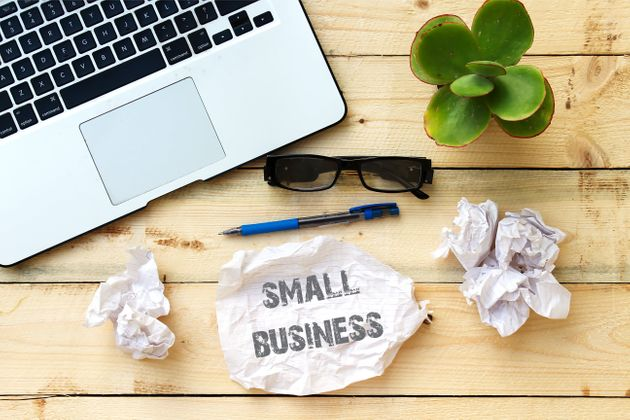 small business on white paper on wooden
