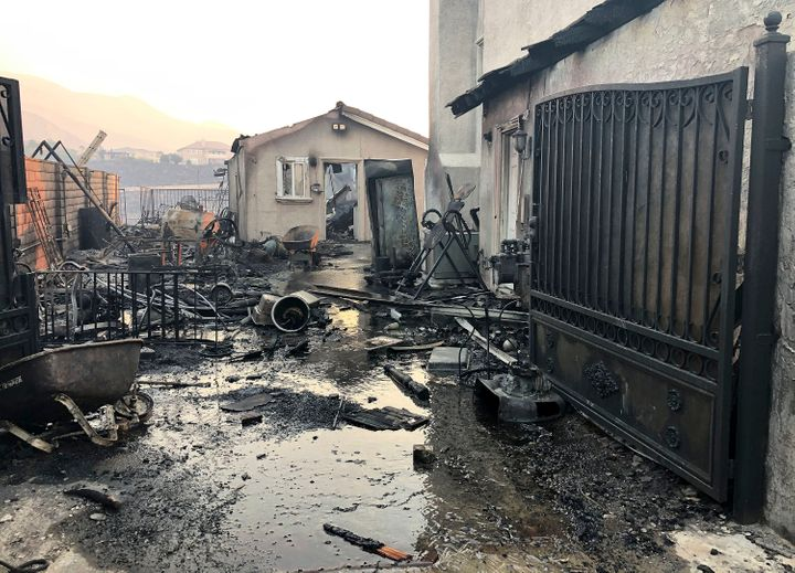 Santa Ana wind driven flames destroyed this home on Beaufait Ave. in Porter Ranch, Calif,. on Friday, Oct. 11, 2019.
