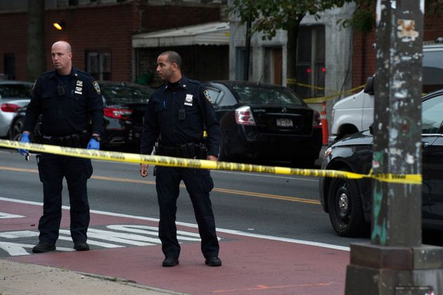 Police are pictured at the scene of a shooting at Triple A Aces club in the Brooklyn borough of New York...