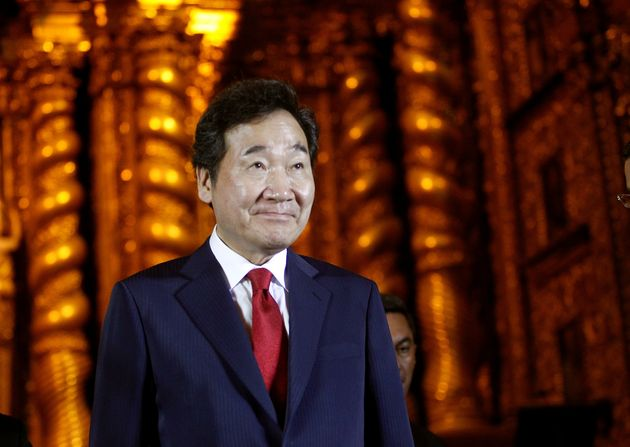 South Korean Prime Minister Lee Nak-yeon looks on at La Compania church during his visit to the country...