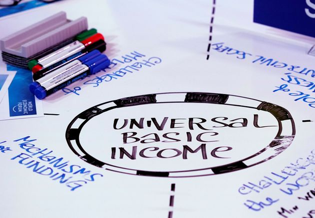 Universal Basic Income (UBI) s written on a table during a session at the World Economic Forum (WEF)...