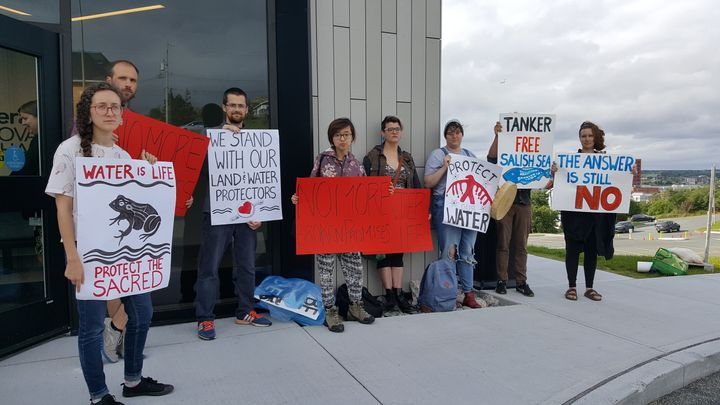 Protesters gather outside a Liberal fundraiser at Memorial University's Signal Hill campus in St. John's on Aug. 6, 2019.
