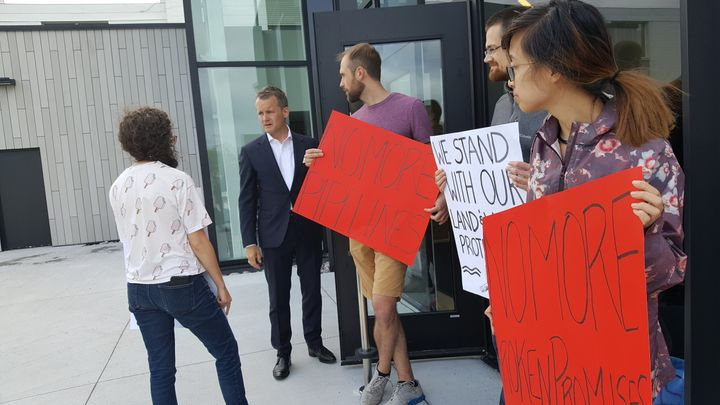 Indigenous Services Minister Seamus O'Regan is confronted by protesters outside a Liberal fundraiser at Memorial University's Signal Hall campus in St. John's on Aug. 6, 2019.