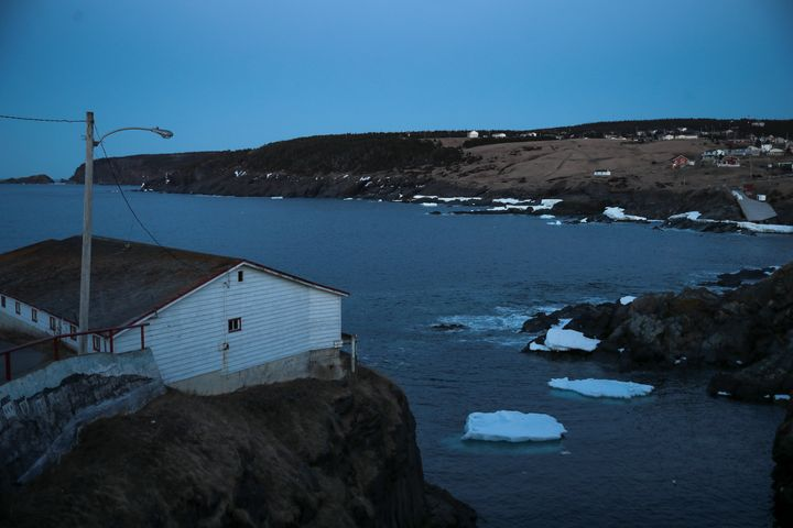 Small icebergs float off the water in Pouch Cove, N.L. at dusk on April 25, 2017.