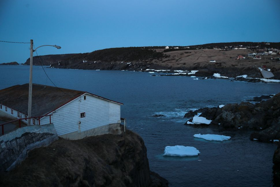 Small icebergs float off the water in Pouch Cove, N.L. at dusk on April 25,