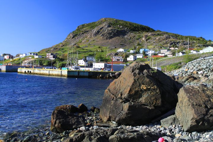 File photo of the shore in Portugal Cove, N.L. Homes are strewn along the hillside. Wharf has ferry to Bell Island.