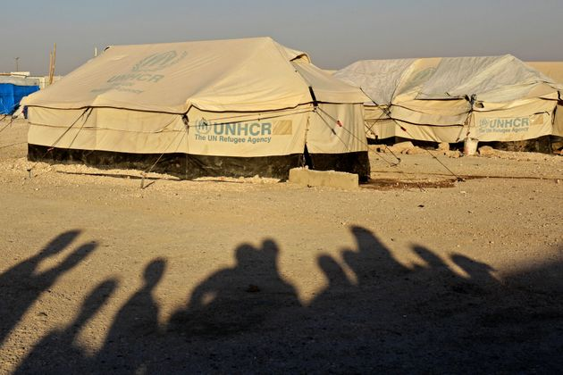 The shadows of displaced people photographed at Ain Issa in